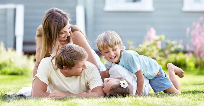 Young family playing in yard